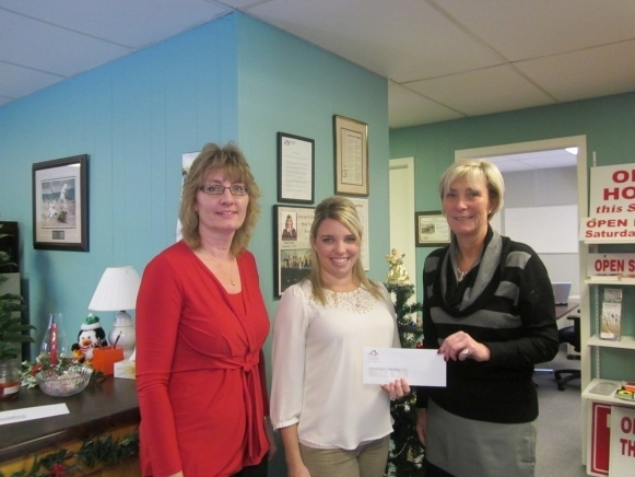 Simcoe & District Real Estate Board cheque presentation to Holmes House